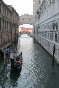 gondolier and bridge of sighs, venice